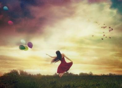 Fille rouge ballons ciel