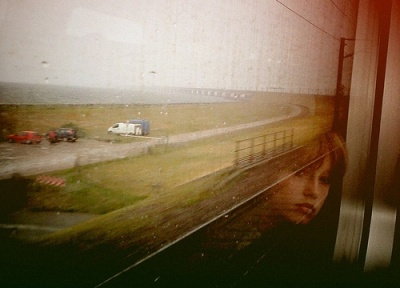 Woman-looking-out-a-train-window-by-BjArn-Giesenbauer-on-Flickr