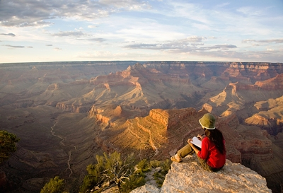 Woman Writing in Journal at Rim of Grand Canyon
