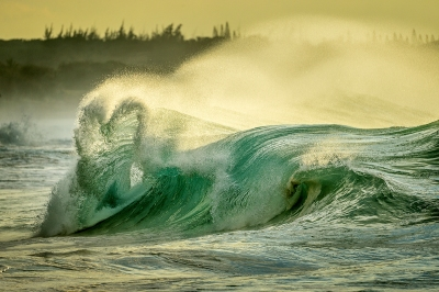 Hearth shaped wave, Papohaku beach, Molokai Hawaii. Storms in the Bering sea pump winter swells onto the shores of Molokai.